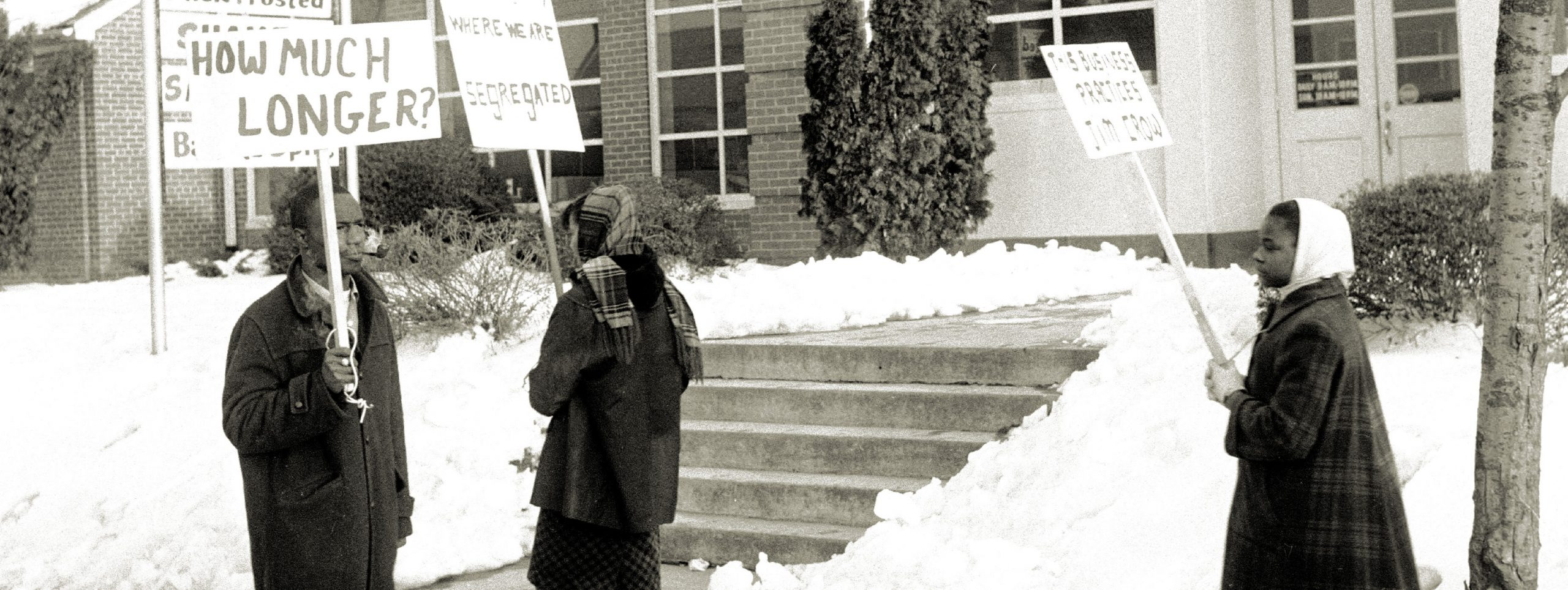 Civil Rights Demonstrators holding picket signs protesting segregation.
